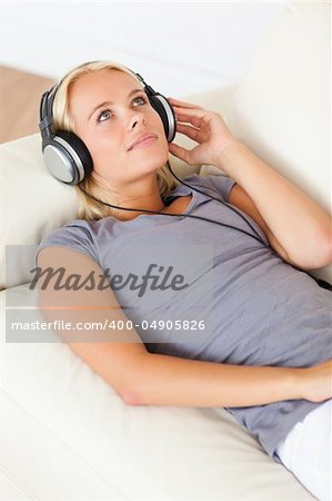 Portrait of a gorgeous woman enjoying some music in her living room