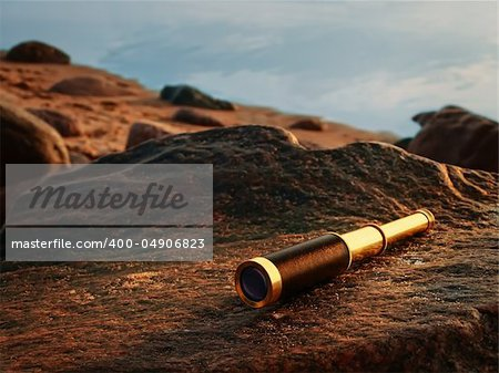 antique brass telescope at sea coast stone Stock Photo - Budget Royalty-Free, Image code: 400-04906823