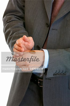 Heads or tails? Businessman holding euro coin on hand isolated on white. Close-up. Stock Photo - Budget Royalty-Free, Image code: 400-04909913