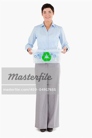 Businesswoman holding a recycling box against a white background