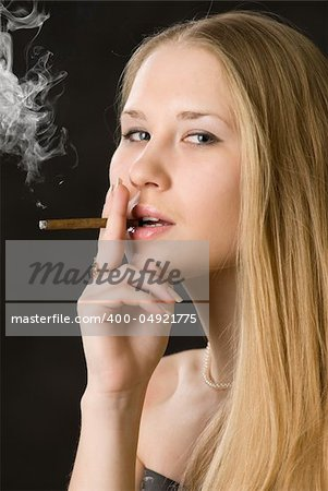 Young cute woman, smoking cigarette Stock Photo - Budget Royalty-Free, Image code: 400-04921775