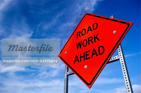 Image of a bright orange road work ahead sign against a blue sky with light clouds Stock Photo - Budget Royalty-Free, Image code: 400-04925891