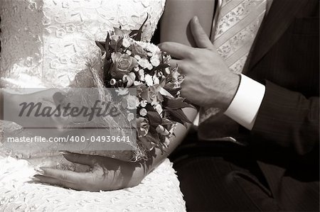Wedding bouquet in hands of the bride. b/w+sepia Stock Photo - Budget Royalty-Free, Image code: 400-04939641