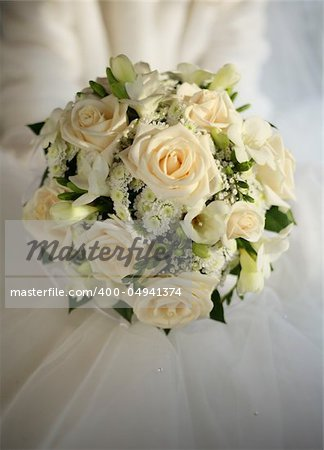 Wedding bouquet from beige roses on a background of a wedding dress Stock Photo - Budget Royalty-Free, Image code: 400-04941374