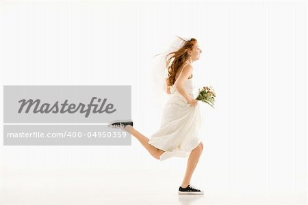 Caucasian bride running and holding bouquet. Stock Photo - Budget Royalty-Free, Image code: 400-04950359