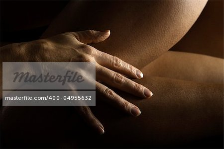 Close up of Caucasian female hand on nude Hispanic female thigh. Stock Photo - Budget Royalty-Free, Image code: 400-04955632