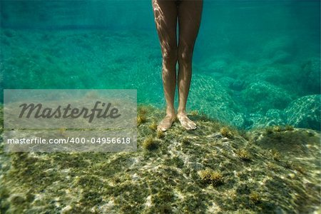 Feet and legs of young Asian nude woman standing underwater. Stock Photo - Budget Royalty-Free, Image code: 400-04956618