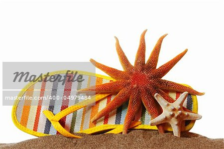 Shoe and starfish on sand with white background