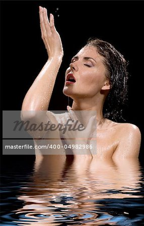 picture of wet brunette girl in water Stock Photo - Budget Royalty-Free, Image code: 400-04982986