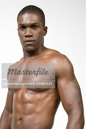 African American Athlete shows some muscle Stock Photo - Budget Royalty-Free, Image code: 400-04987134
