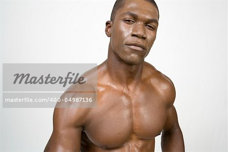 African American Athlete shows some muscle Stock Photo - Budget Royalty-Free, Image code: 400-04987136