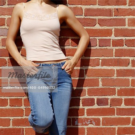 Fashionable closeups of womans mid section against brick wall. Stock Photo - Budget Royalty-Free, Image code: 400-04998332