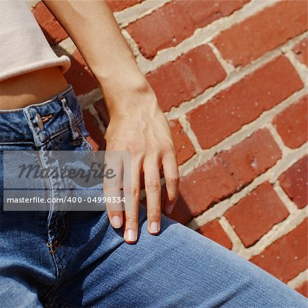 Fashionable closeups of womans mid section against brick wall. Stock Photo - Budget Royalty-Free, Image code: 400-04998334