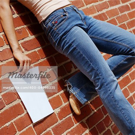 Fashionable girl against red brick wall with blank paper. Stock Photo - Budget Royalty-Free, Image code: 400-04998335