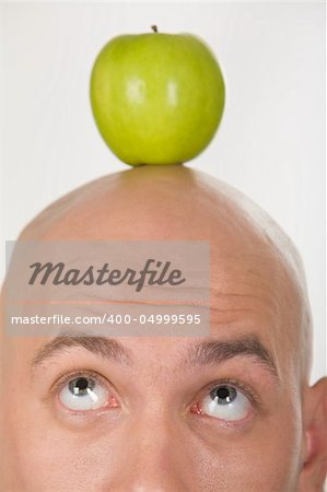Close-up of bald head with green apple on its top Stock Photo - Budget Royalty-Free, Image code: 400-04999595