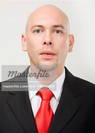Portrait of modern entrepreneur looking at camera Stock Photo - Budget Royalty-Free, Image code: 400-04999600