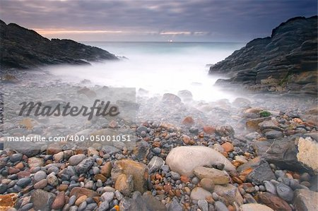 Getting dark in the cove of Kobaron, Bizkaia (Spain) Stock Photo - Budget Royalty-Free, Image code: 400-05001051