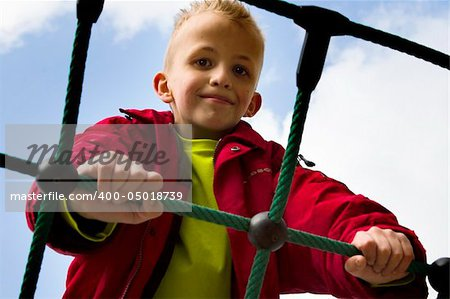 A young boy playing at the playground. Stock Photo - Budget Royalty-Free, Image code: 400-05018739