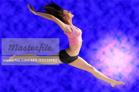 a cute gymnast in a hard jump on a blue background Stock Photo - Budget Royalty-Free, Image code: 400-05038982