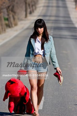 Young woman in the middle of the road with her teddy bear. Stock Photo - Budget Royalty-Free, Image code: 400-05040026