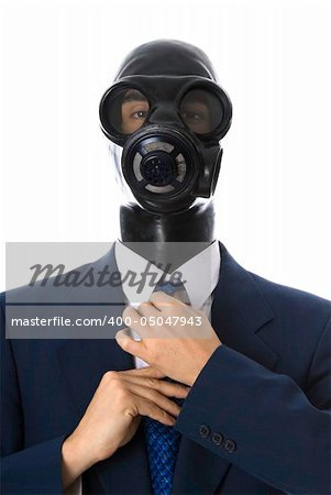 man in a blue suit with a latex mask fixing his tie - Stock Photos