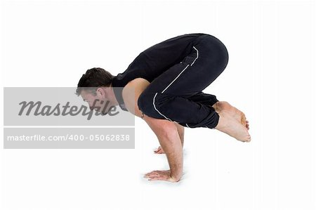 Young male gymnast practicing yoga. Stock Photo - Budget Royalty-Free, Image code: 400-05062838