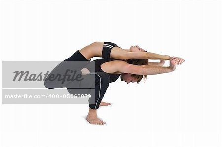 Male and female gymnasts practicing a complex double yoga pose. Stock Photo - Budget Royalty-Free, Image code: 400-05062839