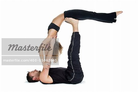 Male and female gymnasts practicing a complex double yoga pose. Stock Photo - Budget Royalty-Free, Image code: 400-05062840