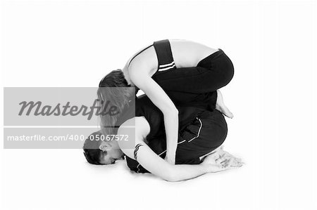 Male and female gymnasts practicing a complex double yoga pose. Stock Photo - Budget Royalty-Free, Image code: 400-05067572