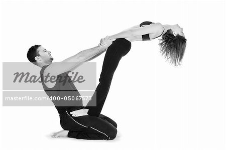 Male and female gymnasts practicing a complex double yoga pose. Stock Photo - Budget Royalty-Free, Image code: 400-05067573