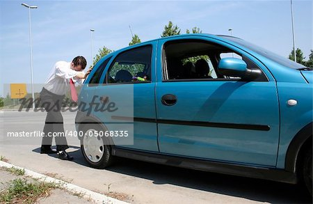 Man pushing a broken car or a car out of gas Stock Photo - Budget Royalty-Free, Image code: 400-05068335
