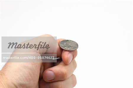 A hand holding a quarter, just about to flip a coin. Stock Photo - Budget Royalty-Free, Image code: 400-05074627