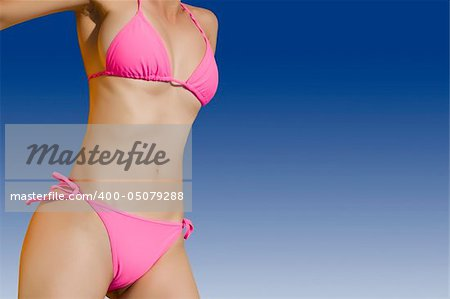 Sexy and fit woman in bright bikini Stock Photo - Budget Royalty-Free, Image code: 400-05079288