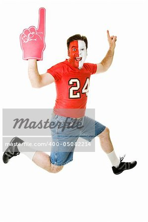 Enthusiastic sports fan jumping for joy over his team's success.  Full body isolated on white. Stock Photo - Budget Royalty-Free, Image code: 400-05082214