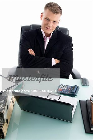 young businessman with crossed arms in an office Stock Photo - Budget Royalty-Free, Image code: 400-05083216