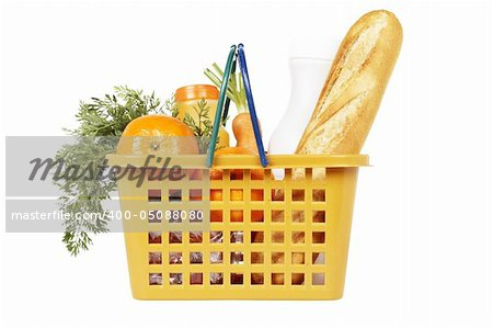 A shopping basket full of groceries isolated on white background Stock Photo - Budget Royalty-Free, Image code: 400-05088080