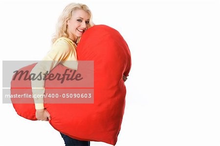 Portrait of pretty young woman with large toy heart giving you fantastic smile Stock Photo - Budget Royalty-Free, Image code: 400-05090603