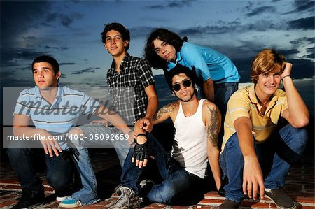Portrait of young trendy group of friends standing with attitude Stock Photo - Budget Royalty-Free, Image code: 400-05092659