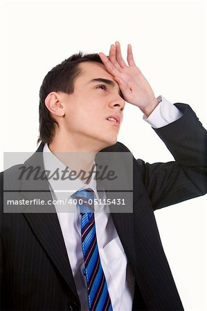 Portrait of tired man touching his head in pain on white background