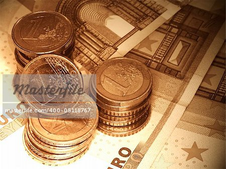 euro coins and notes in sepia tones
