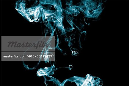 Blue colored smoke curves on black background