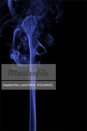 Blue smoke pillar isolated at black background