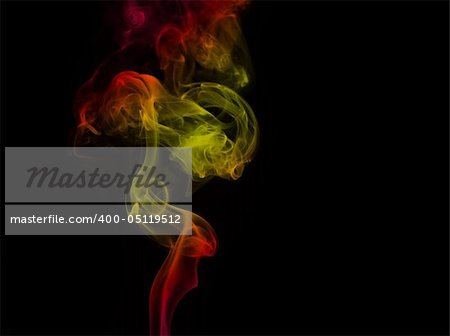 Colored smoke curves isolated on black background