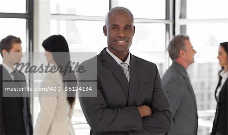 Smiling ethnic business leader in front of team Stock Photo - Budget Royalty-Free, Image code: 400-05124134