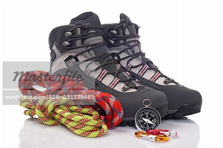 Hiking boots, two rope and compass reflected on white background Stock Photo - Budget Royalty-Free, Image code: 400-05133946