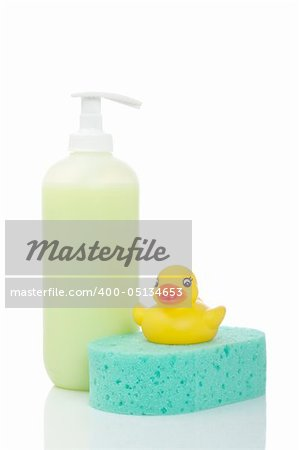 Rubber duck, plastic pump soap bottle and sponge reflected on white background Stock Photo - Budget Royalty-Free, Image code: 400-05134653