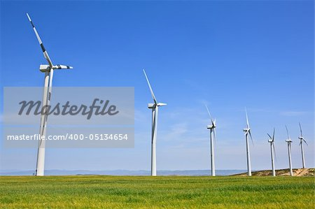 Wind turbines farm in green field over cloudy sky Stock Photo - Budget Royalty-Free, Image code: 400-05134654