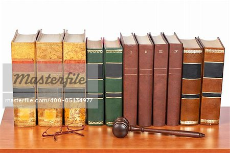 Wooden gavel from the court and old law books reflected on white background. Shallow depth of file Stock Photo - Budget Royalty-Free, Image code: 400-05134977