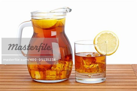 Ice tea pitcher and glasss with lemon and icecubes on wooden background. Shallow depth of field Stock Photo - Budget Royalty-Free, Image code: 400-05135234