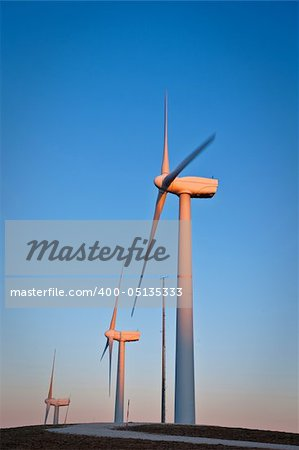 Windmills turning on the sunset in summer. Motion blur Stock Photo - Budget Royalty-Free, Image code: 400-05135333